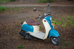 Turquoise scooter Royalty Free Stock Image