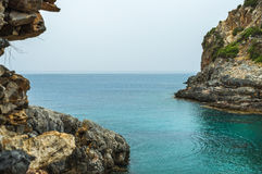 Turquoise sea bay with cliff in Turkey, Mediterranean region Stock Images