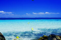 Turquoise sea and blue sky Stock Photos