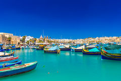 Turquoise sea. Boats in the fishing village captured on turquoise sea stock photography