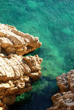 Turquoise sea and cliffs Stock Photography