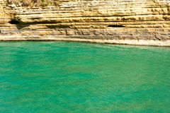 Turquoise sea with cliffs Stock Photography