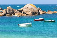 Turquoise sea and fisherman boats Royalty Free Stock Images
