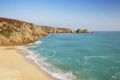 Turquoise sea at Porthcurno Beach in Cornwall, South England Stock Image