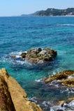 Turquoise sea rocks Stock Photography