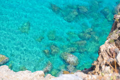 Turquoise sea and rocks Royalty Free Stock Image
