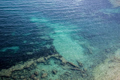Turquoise sea with rocky bottom. Shot on sunny day Stock Images