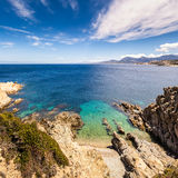 Turquoise sea and rocky coastline at Revellata in Corsica Royalty Free Stock Photo