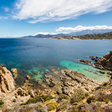 Turquoise sea and rocky coastline at Revellata in Corsica Stock Images