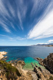 Turquoise sea and rocky coastline at Revellata in Corsica Royalty Free Stock Photography