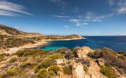 Turquoise sea and rocky coastline at Revellata in Corsica Stock Image