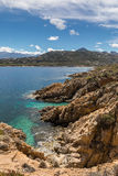 Turquoise sea and rocky coastline at Revellata in Corsica Royalty Free Stock Photos