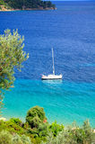 Turquoise sea and a sailing boat, Greece Stock Images