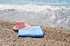 Turquoise sea,sun hat and towel. Stock Photography