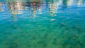 Turquoise sea surface background with reflections in the water stock photos