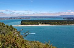 The turquoise sea that surrounds Mount Maunganui in North Island, New Zealand stock images