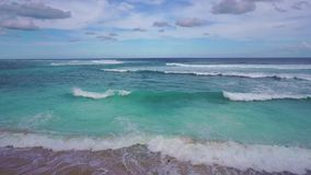 Turquoise sea view with big waves on Bali, Indonesia stock footage