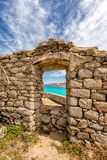 Turquoise sea viewed through window of derelict building in Cors Stock Photo