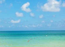 Turquoise sea water and blue sky. Royalty Free Stock Photography