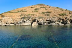 Turquoise sea water in Kolona double bay Kythnos island Cyclades Greece. Travel destinations September 2018. Horizontal royalty free stock images