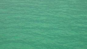 Turquoise sea water surface. Shot with a Sony RX10 IV fps 59,94 FHD stock footage