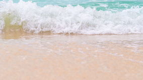 Turquoise sea water waves and sand beach stock footage