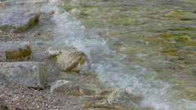 Sea water waves and sea shore. Turquoise sea water waves and sand beach stock video footage