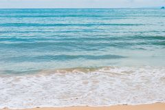 Turquoise sea water and white foam waves on  beach Stock Photos