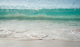 Turquoise Sea wave. Little sea wave arriving on the beach with transparent turquoise color Stock Photos