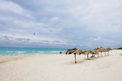 Parasols on sandy beach. Scenic view of parasols on sandy beach in Cuba Royalty Free Stock Photography