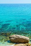 Turquoise Seawater surface and beach in Greece stock photography