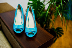 Turquoise shoes with ribbons Royalty Free Stock Images
