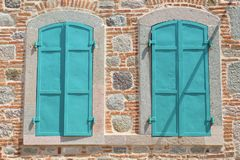 Turquoise shutters and old stone walls from Pergamon antique city, Turkey. Blur blue shutter shutters old red walls pergamon antique city turkey rough history royalty free stock photo