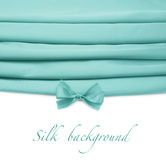 Turquoise silk with bow Royalty Free Stock Images