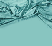 Turquoise silk fabric background Royalty Free Stock Image