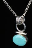 Turquoise silver necklace isolated. Turquoise silver necklace over black background royalty free stock photo