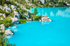 Turquoise Sorapis Lake  in Cortina d'Ampezzo, with Dolomite Moun. Tains and Forest - Sorapis Circuit, Dolomites, Italy, Europe Royalty Free Stock Photo