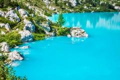 Turquoise Sorapis Lake  in Cortina d'Ampezzo, with Dolomite Moun Royalty Free Stock Photo