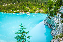 Turquoise Sorapis Lake in Cortina d'Ampezzo, with Dolomite Moun. Tains and Forest - Sorapis Circuit, Dolomites, Italy, Europe stock photos