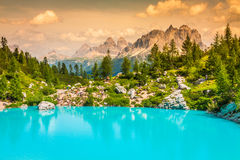 Turquoise Sorapis Lake  in Cortina d'Ampezzo, with Dolomite Moun. Tains and Forest - Sorapis Circuit, Dolomites, Italy, Europe Royalty Free Stock Photos