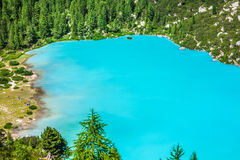 Turquoise Sorapis Lake  in Cortina d'Ampezzo, with Dolomite Moun. Tains and Forest - Sorapis Circuit, Dolomites, Italy, Europe Royalty Free Stock Photography