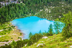 Turquoise Sorapis Lake in Cortina d'Ampezzo, with Dolomite Moun. Tains and Forest - Sorapis Circuit, Dolomites, Italy, Europe royalty free stock image