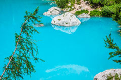 Turquoise Sorapis Lake with Pine Trees and Dolomite Mountains in Royalty Free Stock Photography