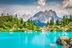 Turquoise Sorapis Lake with Pine Trees and Dolomite Mountains in. The Back - Sorapis Circuit, Dolomites, Italy, Europe Stock Image