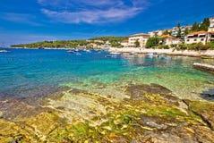 Turquoise stone beach on Hvar island Royalty Free Stock Photo