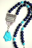 Turquoise stone antic necklace. Precious natural stone colour beads: turquoise lapis lazuli jasper beads with pendant, in ethnic Oriental style necklace stock images