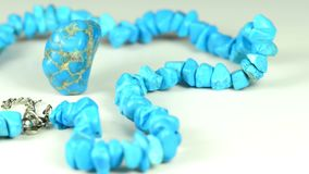 Turquoise stone and neck lace. On a turn table stock footage