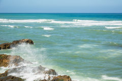 Turquoise sunlit ocean in summer. Royalty Free Stock Image