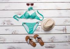 Turquoise swimsuit and aviator sunglasses. Stock Photos