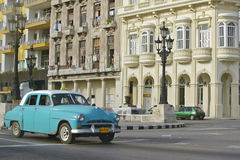 Turquoise taxi driving the streets of Old Havana, Cuba Stock Photo